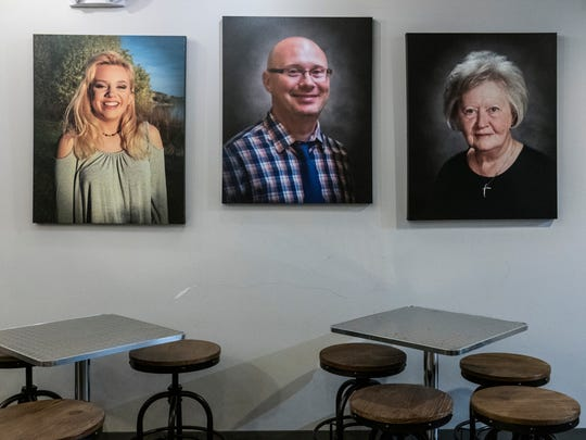 Pictures of Sophie Rinehart (left to right), David Rinehart and Ruth Ann Rinehart are displayed as a memorial in the Press 38 Coffee shop inside the Foundry Center for the Arts in Newburgh. Last November, the Rineharts were killed by a drunk driver in a car accident on Interstate 69 last November.
