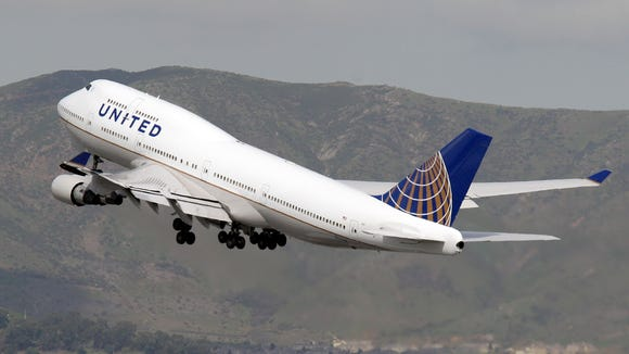 A United Airlines Boeing  747-400, the first 747 entering