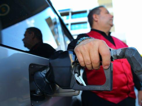 Rainer Betancout pumps gas in Miami, Florida.