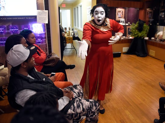 New Hope mime dancer Natalee Razor performs during the Annual community Kwanzaa Celebration at the Evansville African American Museum Tuesday.