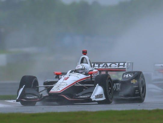 IndyCar driver Josef Newgarden (1) kicks up a water