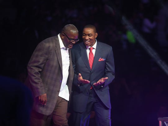Former Pistons guards Isiah Thomas (right) and Joe Dumars are introduced during a halftime ceremony honoring the Bad Boys' 25-year reunion March 28, 2014 at the Palace of Auburn Hills.
