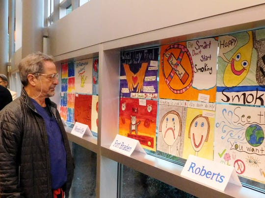 Dr. Sergio Ginaldi enjoys the artwork on display.