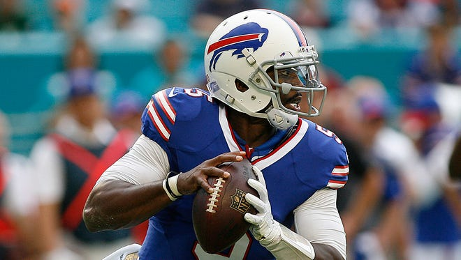 Bills quarterback Tyrod Taylor rolls out in the first quarter against the Miami Dolphins at Sun Life Stadium.