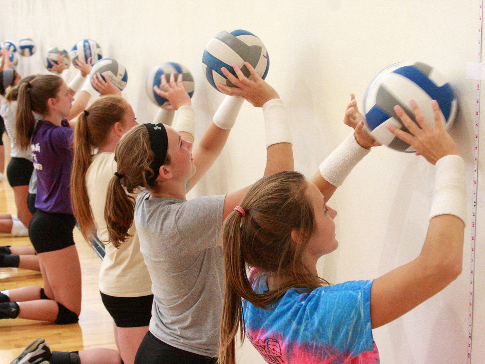 Lakeview High School volleyball players practice the basics during tryouts on Wednesday.