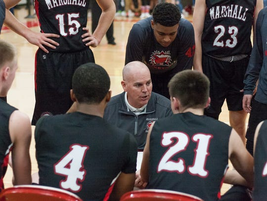 Marshall coach, Doug Riegel talks to his team during