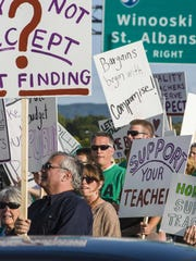 Teachers and their supporters honk and wave along Williston Road at a gathering sponsored by the Burlington Education Association on Sept. 27.