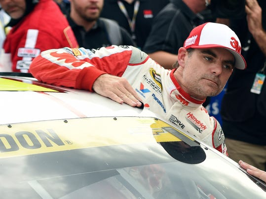 Jeff Gordon (24) climbs out of his car after winning the pole during qualifying for the NASCAR Sprint Cup Series auto race at Talladega Superspeedway Saturday, Oct. 24, 2015, in Talladega, Ala. (AP Photo/ Mark Almond)