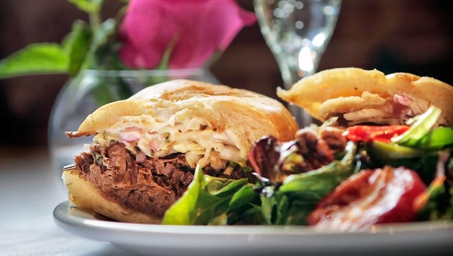 May 10, 2015 - Rizzo's Diner on South Main Street serves a beef brisket po'boy for brunch with horseradish ailoli, house made spicy pepper slaw, and Debris Gravy.