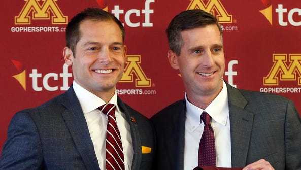 Minnesota athletic director Mark Coyle, right, introduces