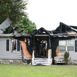 Neighbors save 2 dogs from fire that gutted house in Laurel