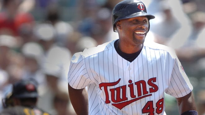 File Photo: Minnesota Twins outfielder Torii Hunter heads to the dugout after batting against the Pittsburgh Pirates during the Twin last spring training game in 2007 at Hammond Stadium in the Lee County Sports Complex in Fort Myers.
