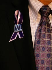 A detail of Rep. John Blanton, R-Slayersville, pin supporting Marsy's Law after it's passage in the House during the General Assembly at the Kentucky State Capitol in Frankfort, Ky., on Wednesday, January 24, 2018.