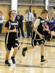 Amy Smith (1) and Jeffery Stedge run up the court after a basket during a Corning Unified Sports basketball intrasquad game May 15 at Corning-Painted Post High School. Corning was scheduled to play Union-Endicott, but the Tigers couldn't make it because of the threat of severe weather.