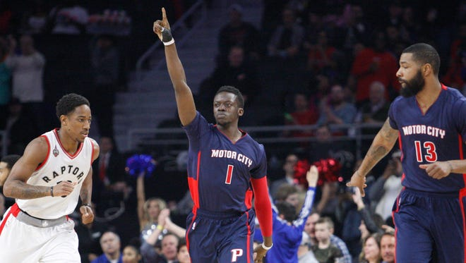Pistons guard Reggie Jackson (1) points straight up in celebration after making a shot against the Raptors during the first quarter at The Palace of Auburn Hills Sunday.
