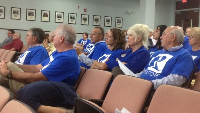 People wearing blue Realtor shirts are filling the Brevard County Commission chambers tonight for a discussion of transportation impact fees, sales taxes and gas taxes.