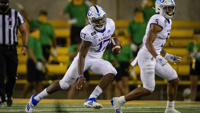 Kansas freshman quarterback Jalon Daniels scrambles during Saturday's game against Baylor in Waco, Texas. Daniels finished 19-for-33 passing for 159 yards and added 14 carries for 23 yards in his first career start, a 47-14 defeat.