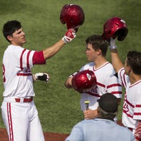 Indiana's Craig Dedelow, left, celebrates with teammates at home plate after hitting a two-run home run in the 7th inning during an NCAA college baseball game, May 15, 2015, at Bart Kaufman Field in Bloomington.