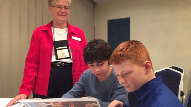 """""""It teaches them about government and teaches them about leadership,"""" says Michigan Youth in Government assistant director Fran Bregger, with middle schoolers Evan Atherton, 13, and Boe Eckman, 12, right, both of White Pigeon."""