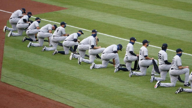 Yankees players kneel before the game against the Nationals on Thursday at Nationals.