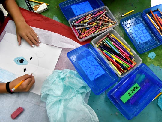 Students in Lianne Arce's art classes use pencils, markers, paints, and tissue paper throughout the day on Friday, Dec. 16, 2016, at Beachland Elementary School in Vero Beach. Mrs. Arce utilizes crowdsource funding to help pay for those supplies.