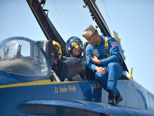US Navy Blue Angels pilot Lt. Andre Webb (right) talks