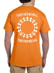 The orange gun-violence awareness shirts Marlboro High School students will be wearing each week for the rest of the school year.