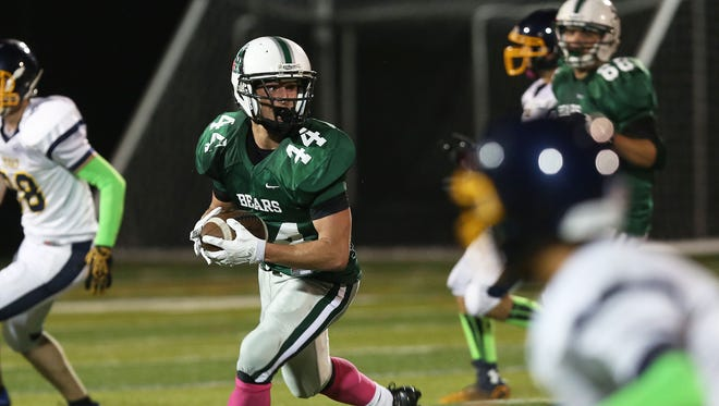 Brewster's Jack Guida (44) find some running room in the Walter Panas defense during football game at Brewster High School Oct. 9, 2015. Guida scored three first half touchdowns.