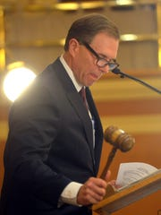 Speaker of the House Mark Mickelson raps the gavel before the State of the State address Tuesday in Pierre.