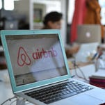 A picture shows the logo of online lodging service Airbnb displayed on a computer screen in the Airbnb offices in Paris on April 21, 2015.