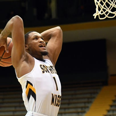 Southern Miss'  Cortez Edwards dunks the ball in a
