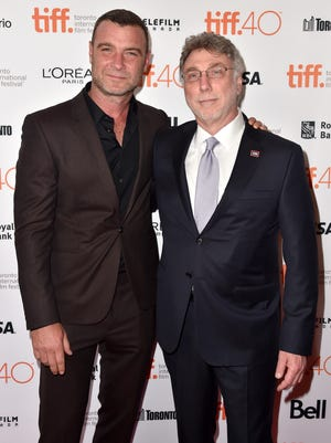"Actor Liev Schreiber and Washington Post editor Marty Baron at the ""Spotlight"" premiere during the 2015 Toronto International Film Festival."