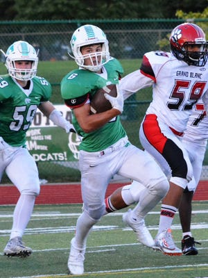 Novi's Anthony D'Annibale (with ball) caught a 53-yard TD pass and added an 89-yard kickoff return.