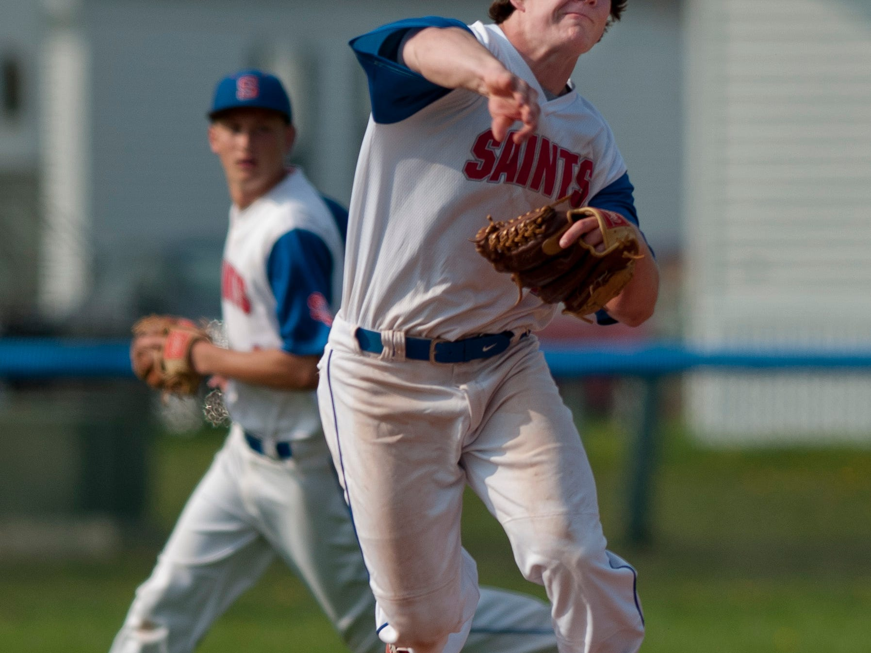 St. Clair's Jared Ambrose throws the ball to first during a baseball game Wednesday, May 6, 2015 at St. Clair High School.