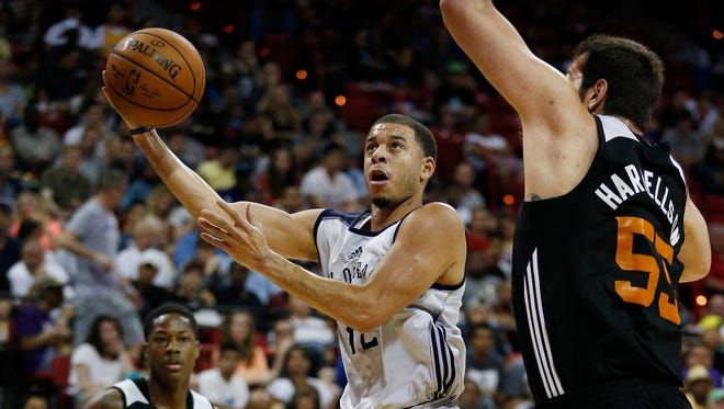 Seth Curry shoots over Josh Harrellson during the first half of an NBA summer league basketball game Sunday, July 19, 2015, in Las Vegas.