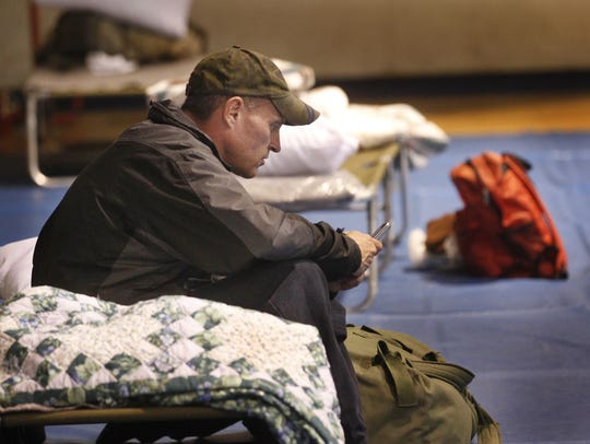 Steven Ring passes time at the warming shelter in the