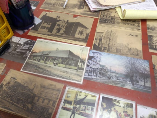 Old time photos and memorabilia under glass at the