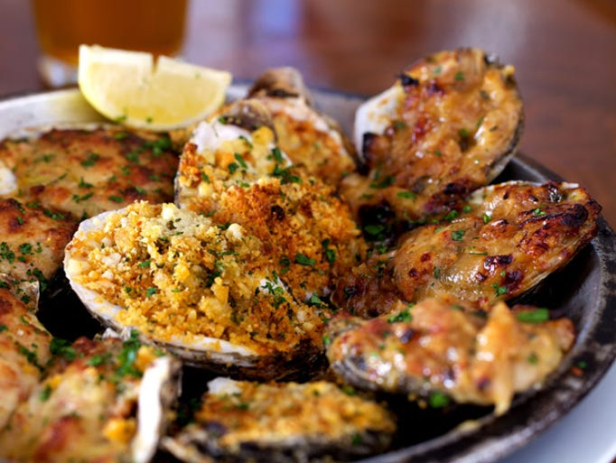 Taste baked oysters on a Creole Pub Crawl in New Orleans. Sam Hanna