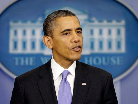 FILE - In this Dec. 20, 2013 file photo, President Barack Obama speaks during an end-of-the year news conference in the Brady Press Briefing Room at the White House in Washington. Capping a monthslong review, Obama is expected to back modest changes to the government?s surveillance network at home and abroad while largely leaving the framework of the controversial programs in place, including the bulk collection of phone records from millions of Americans.  (AP Photo/Pablo Martinez Monsivais, File)