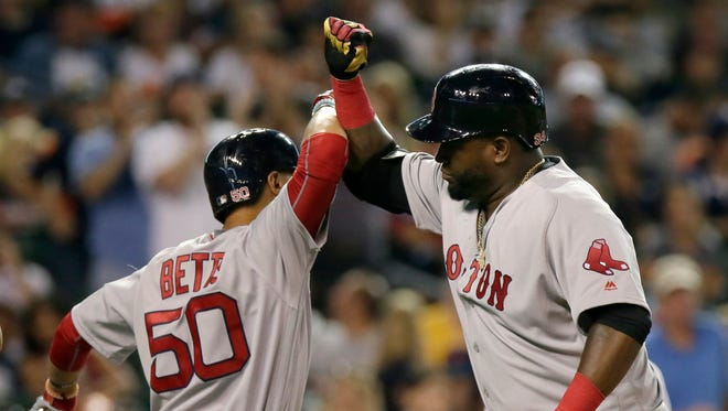 David Ortiz celebrates with Mookie Betts after hitting a two-run home run for the second straight night.