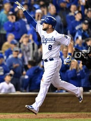 Mike Moustakas reacts after hitting a solo home run