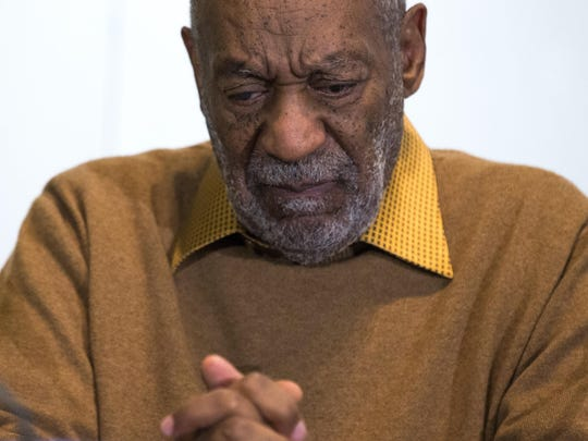 Bill Cosby pauses during a news conference in 2014