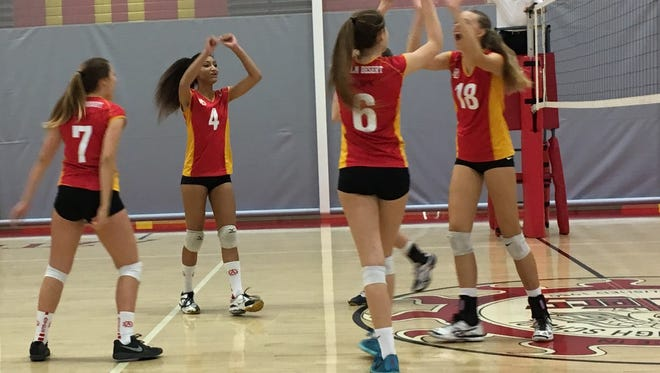 Palm Desert players celebrate a point won on Tuesday night against Upland. The Aztecs lost the match 3-1.