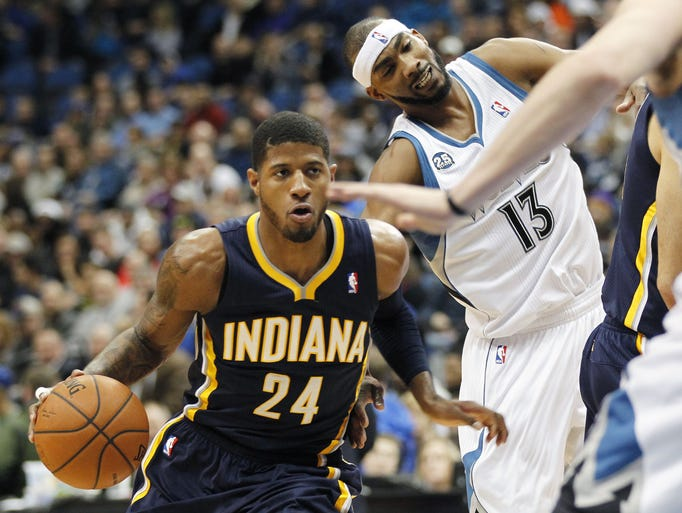 Indiana Pacers forward Paul George (24) drives past Minnesota Timberwolves forward Corey Brewer (13) during the first period of their NBA basketball game, Wednesday, Feb. 19, 2014 in Minneapolis. (AP Photo/Andy Clayton-King)