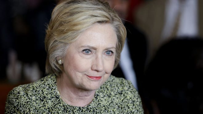 Democratic presidential hopeful Hillary Clinton talks to community leaders and politicians at the Jackson Diner in the Queens borough of New York, Monday, April 11, 2016. (AP Photo/Seth Wenig)