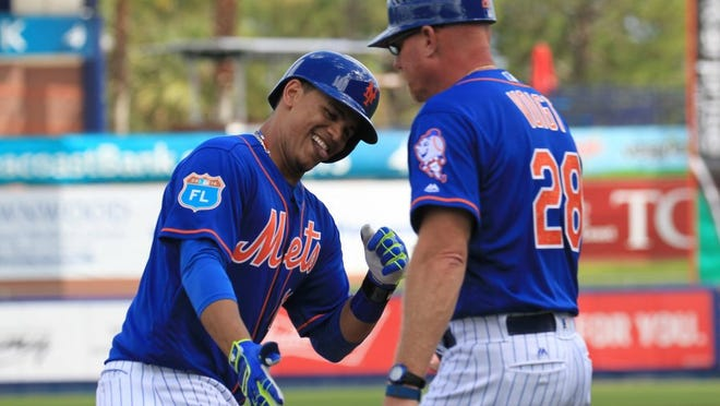 The New York Mets are hoping center fielder Juan Lagares (left) can make strides at the plate this season.