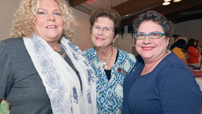 Artists Anita Prentice and Holly Theuns with Jane Rowley of Dyer Chevrolet FP (center)