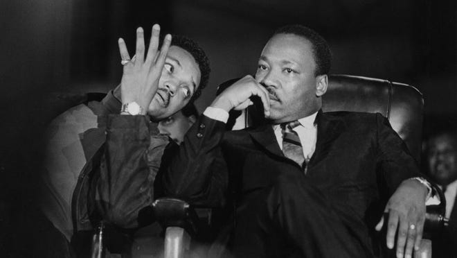 Wednesday, April 3, 1968 - Martin Luther King, seated with aide Jesse Jackson, arrived at the Mason Temple where Ralph Abernathy made a lengthy introduction for the civil rights leader. (Ken Ross, courtesy Special Collections/University of Memphis Libraries)