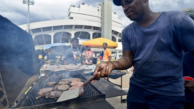 Terry Hunter from Memphis is just happy to be grilling in the shadow of the Liberty Bowl during the 27th annual Southern Heritage Classic in Memphis on Sept. 10, 2016. Thousands were on hand for the annual event. Music, food and dancing act to set the stage for the gridiron action between Tennessee State and Jackson State.