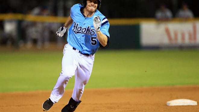 GABE HERNANDEZ/CALLER-TIMES The Hooks' Drew Ferguson runs to third base against Midland during the Texas League South Division Series on Wednesday, Sept. 7, 2016, at Whataburger Field in Corpus Christi.